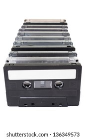 Row of vintage audio tapes over white background