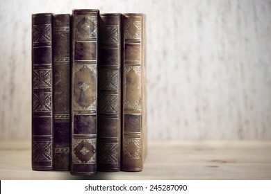 Row of vintage books with one book pulled out