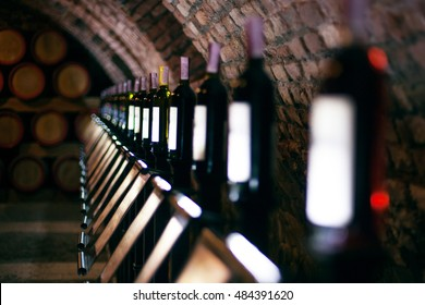 Row of vintage wine bottles in a wine cellar