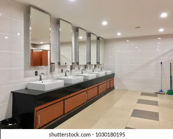 Row of wash sink and mirror in public toilet, restroom decoration