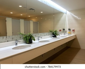 Row of wash sink in public toilet, interior decoration for restroom