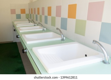 row of washbasins in building of modern camping