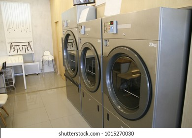 Laundry store images stock photos vectors shutterstock row of washing machine of laundry business in the public store solutioingenieria Image collections