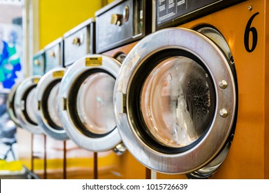 Row of washing machines in a laundromat