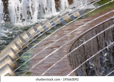 Row of water jets in a fountain. Close-up