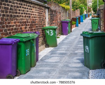 A Row Of Wheelie Bins In An Alleyway In A British City