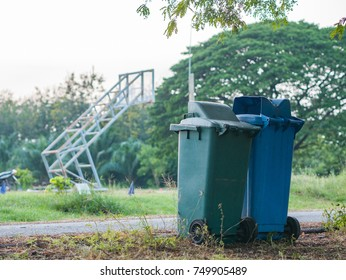 Row of Wheelie Bins and opening the lid for rubbish, Public bin at park