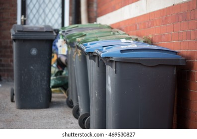 Row of wheelie bins stacking up in the UK outside house