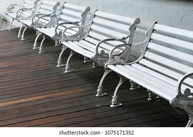 Row of white benches