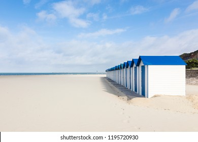 Row of white and blue beach huts at Boulogn-sur-Mer, Pas-de-Calais, France