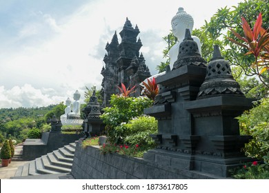 Row of white cement buddha statue with sunlight. A row of white Buddha statues at the Brahma Vihara Arama Temple in Bali