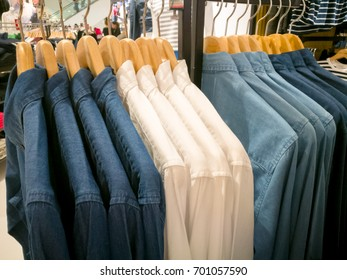 row of white and dark shirt on the shopping mall
