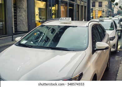 row of white taxi in Milan