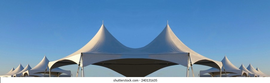 row of white tent tops