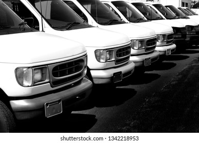 Row of white vans to deliver cargo truck transportation and delivery