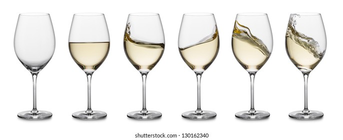 row of white wine glasses, full, empty and with splashes.