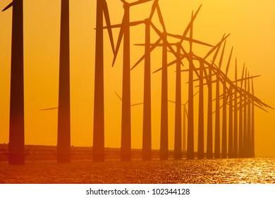 Row of wind turbine producing alternative energy