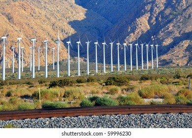 Row of windmills against the mountains.