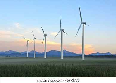 A row of windmills at dusk in pincher creek, alberta, canada. These wind turbines make pincher creek the wind energy capital of canada