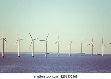 Row of Windmills in the Ocean