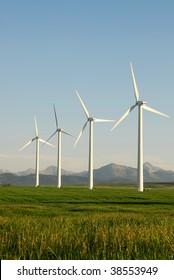 A row of windmills on plain at pincher creek, alberta, canada. These wind turbines make pincher creek the wind energy capital of canada.
