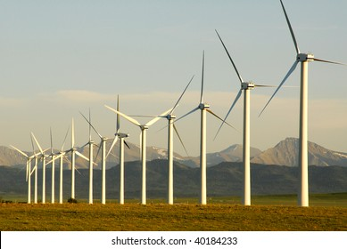 A row of windmills on prairie at pincher creek, alberta, canada. These wind turbines make pincher creek the wind energy capital of canada.