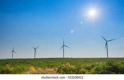 A row of windmills on prairie . These wind turbines make pincher creek the wind energy capital in thailand