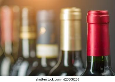 Row of  wine bottles in wine cellar. Low depth of field.