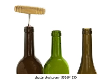 A row of wine bottles, one corked and with a corkscrew, side view on white background