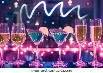 Row of wine, cocktail, champaign drinks on bar. Party, alcohol, club, nightlife concept.