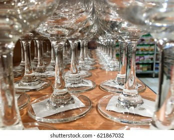 Row of wine glasses on a display table