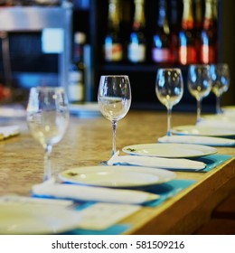 Row of wine glasses on the table in restaurant, bar or at wedding reception