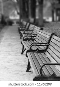 A row of wood and metal benches