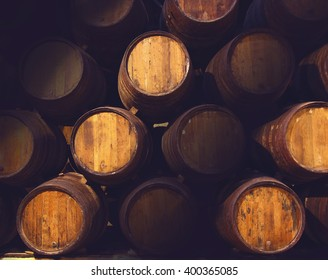 Row of wooden barrels of tawny portwine ( port wine vine) in cellar, Porto, Portugal. Vintage old style