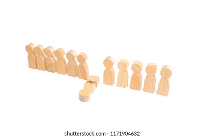 A row of wooden people and a broken figure of a person among them. The concept of a weak link. Did not give up to expectations and did not fulfill the task. Weak player, worker for dismissal.