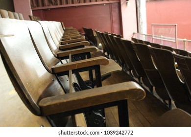 Row of wooden seats in old empty historic theater building