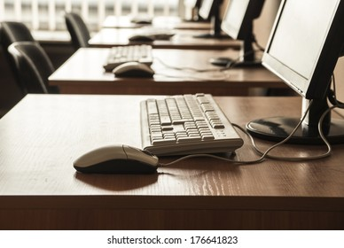 Row of workplaces with computers in office