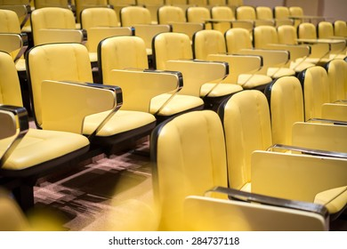 Row of yellow seat in auditorium prepare for study or conference or show