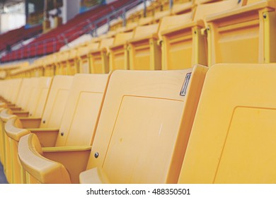 Row of yellow seats on main stand.