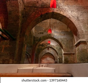 Rowboat at the underground Pool of Arches in Ramla. Israel. Pool built during the reign of the caliph Haroun al-Rashid in 789 AD