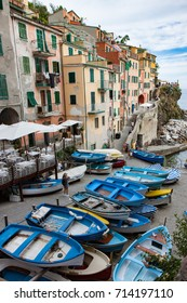 Rowboats at the Riomaggiore Harbor in Cinque Terre Italy