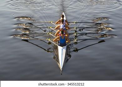 rowers paddling in a beautiful italian lake