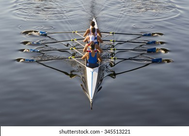 rowers paddling in a beautiful italian lake