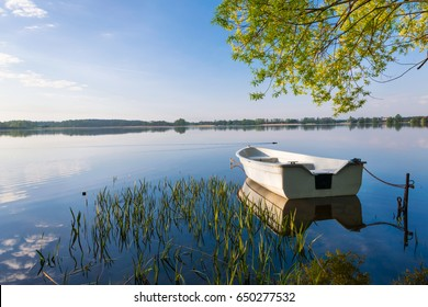 Rowing boat floating over the Lake Selment Wielki waters. Masuria, Poland.