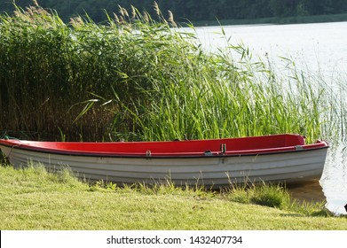 Rowing boat on the lakeside of a river