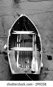 rowing boat on mudflats, taken from harbor wall