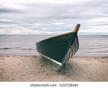 Rowing boat on sandy beach