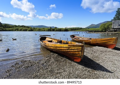 Rowing boat at side of Derwent Water in Lake District National Park Cumbria England