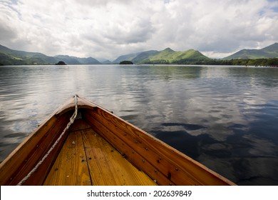 Rowing boats in Lake District near Windermere, England.