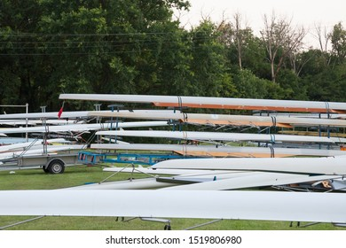 Rowing boats, Sweep oar style, being stored and maintained at sunset, near the Palic lake, in northern Serbia. A Sweep oar bat is used by four or eight persons propelling it